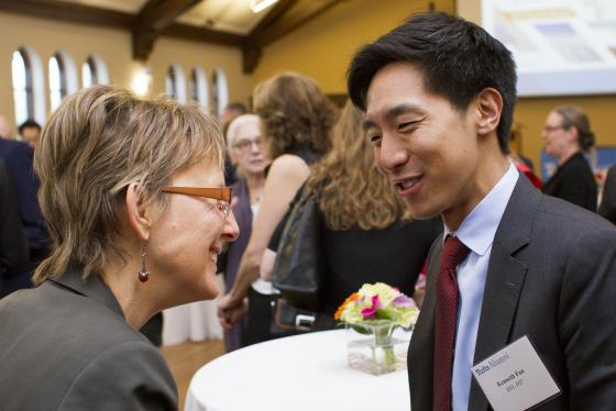 Conversation between two people at alumni awards banquet