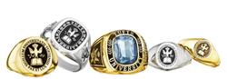 Five Tufts class rings of various styles and metals