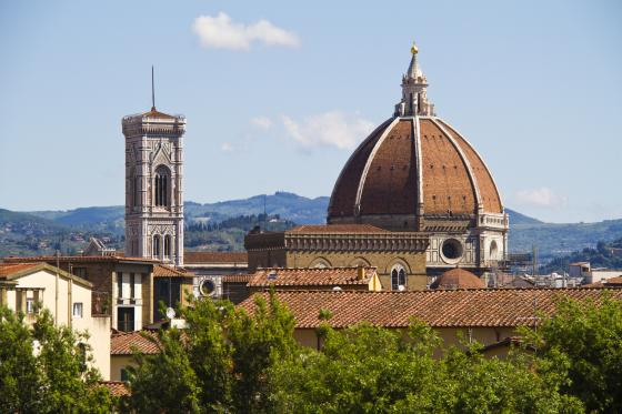 Dome in city and countryside skyline Italy
