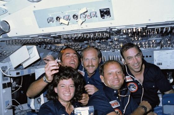 Frederick Hauck with fellow astronauts in space shuttle