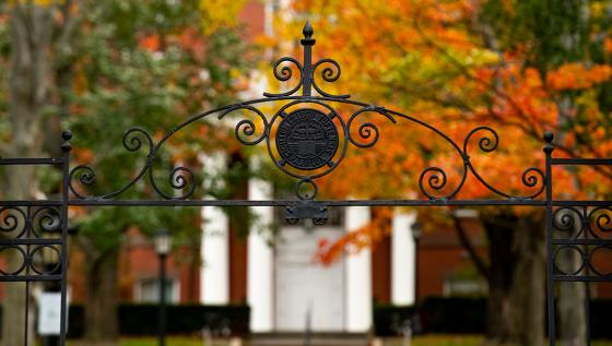 The gate on Professors Row, with Ballou Hall in the background, on Tufts University's Medford/Somerville campus.