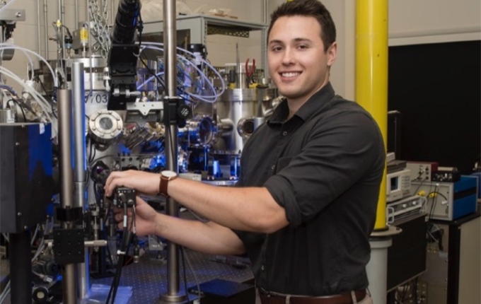 Colby Azersky, E19, EG20, poses with NASA machinery