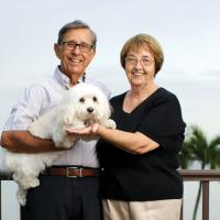 Jean and Louis Fiore holding a white lap dog